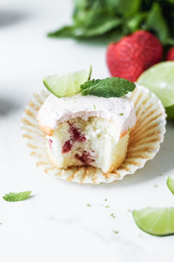 strawberry mojito cupcakes with limes on top and bite taken out