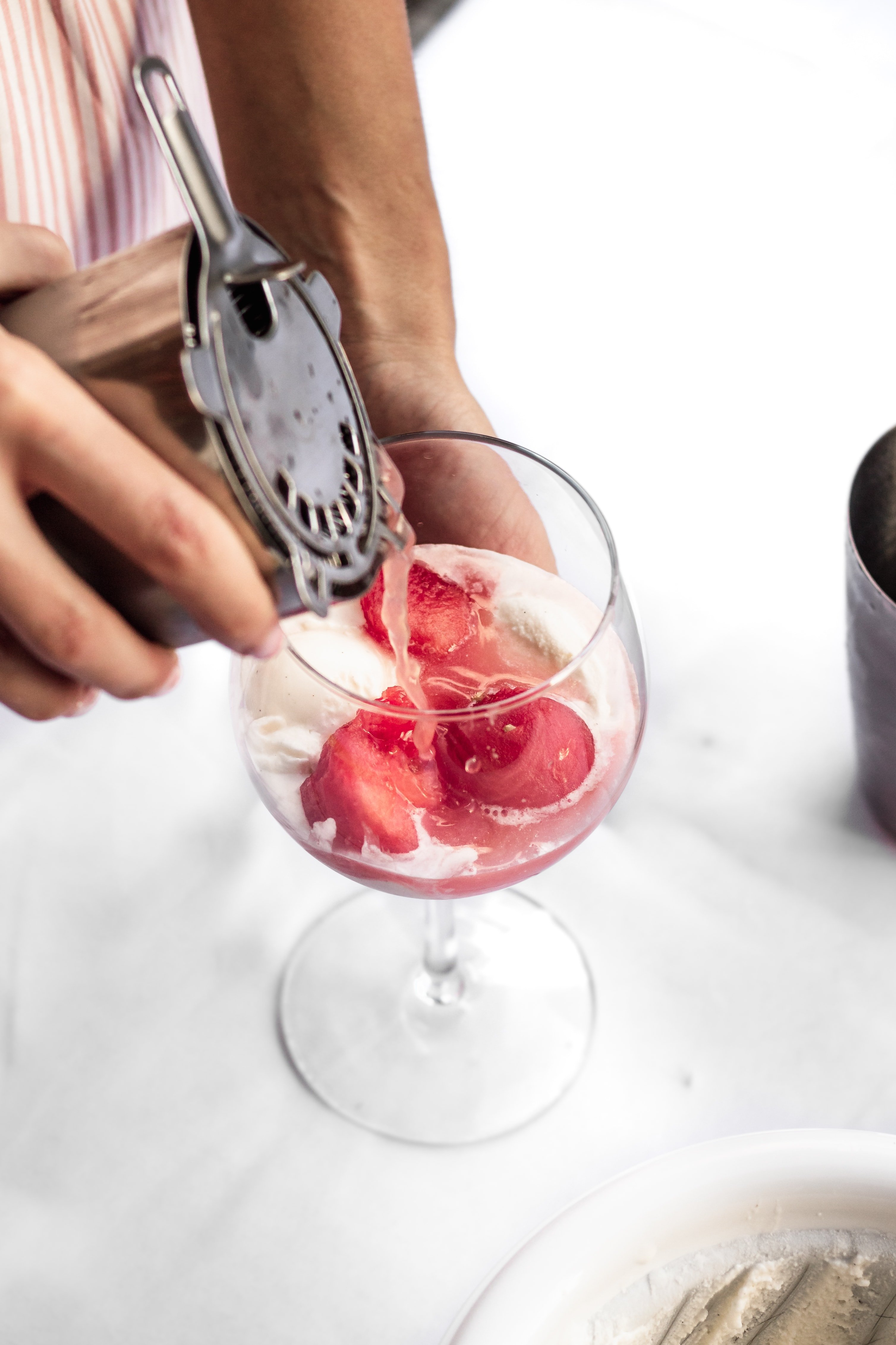 cocktail pouring over homemade ice cream