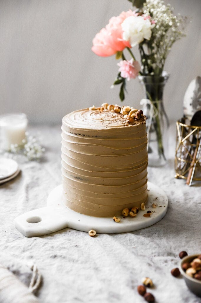 tall cake with toasted hazelnuts and chocolate shavings