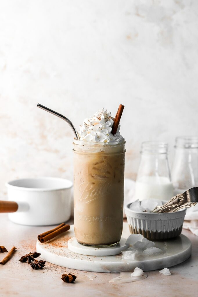 chai latte, iced with whipped cream and cinnamon