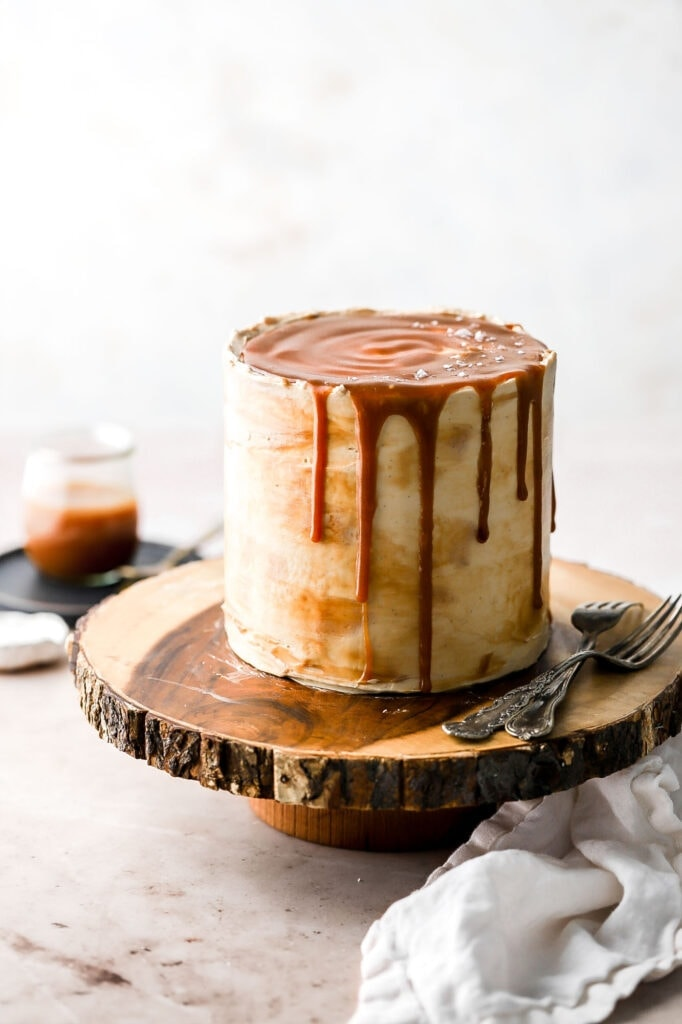 layer cake with vanilla buttercream and bourbon salted caramel sauce