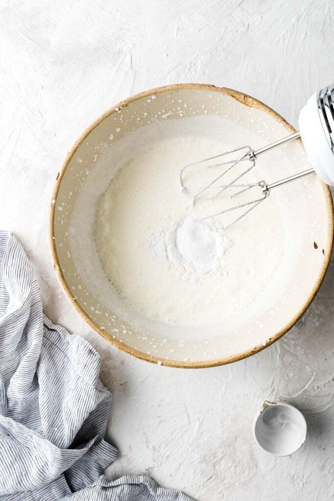 whipped cream thickened slightly, add powdered sugar