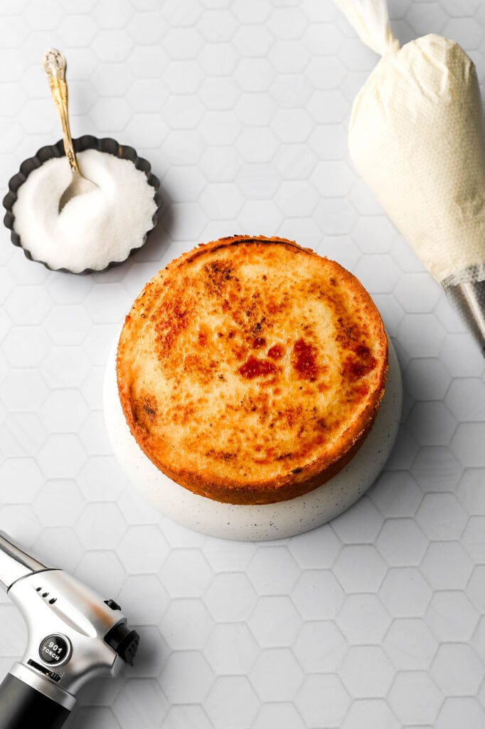 use kitchen torch to burn sugar on top of cake
