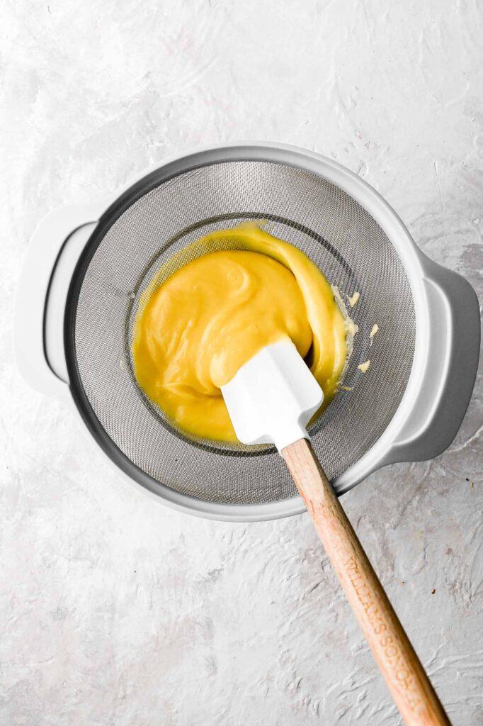 push pastry cream through sieve