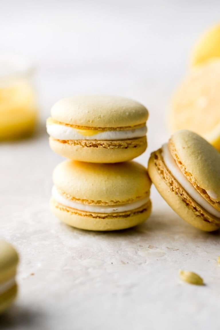 lemon macarons with cream cheese frosting and lemon curd