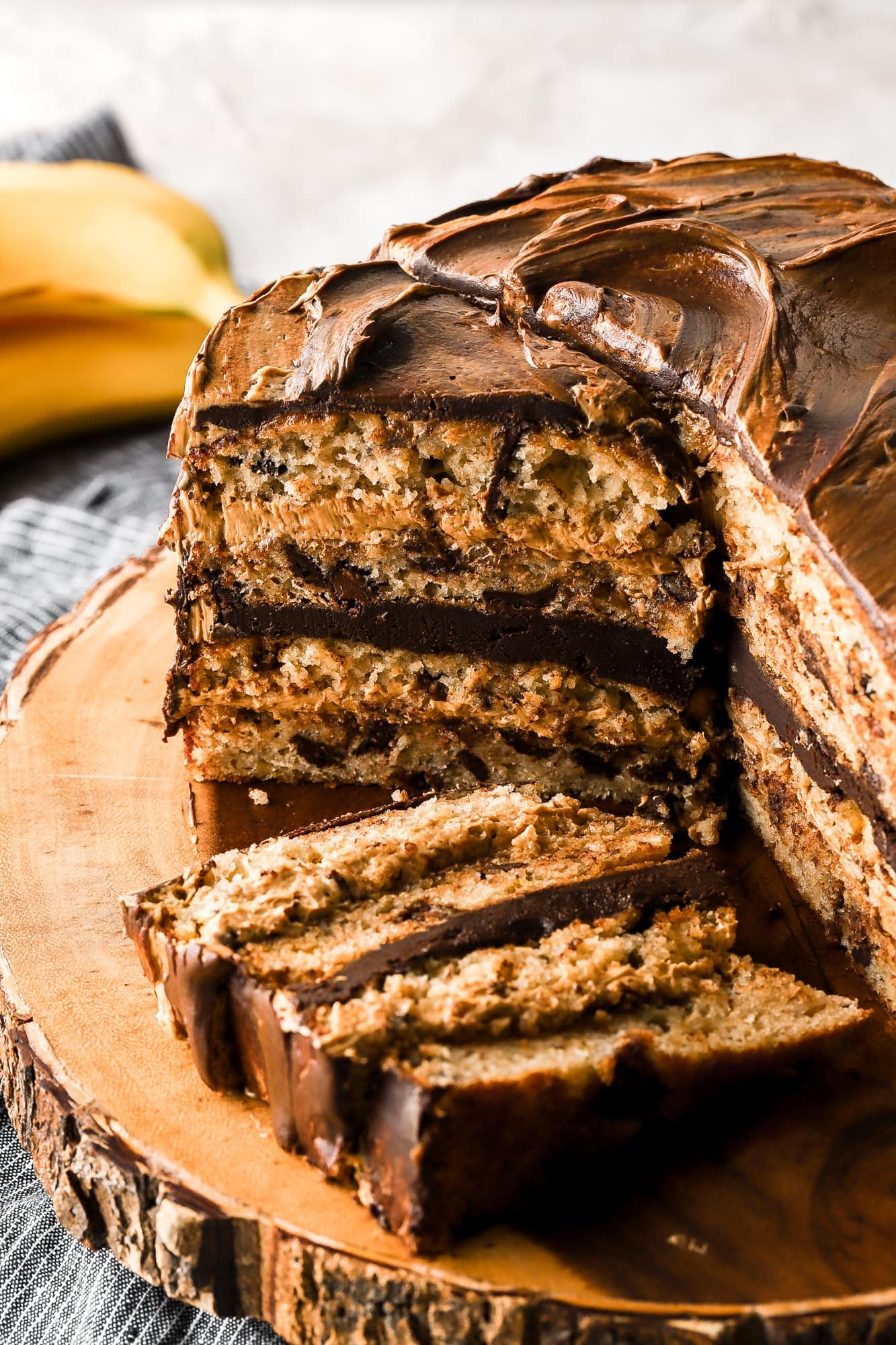 peanut butter banana chocolate chip cake with cut slice