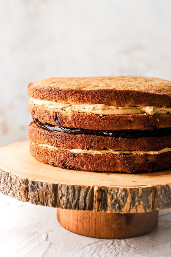 banana cake layers with peanut butter Swiss meringue buttercream and chocolate ganache