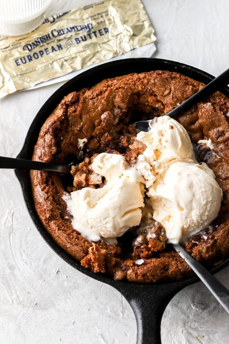 skillet cookie with ice cream and spoons