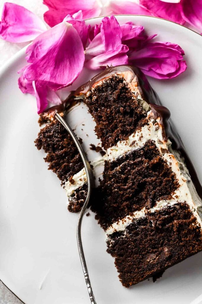 close up of slice of chocolate cake with almond buttercream