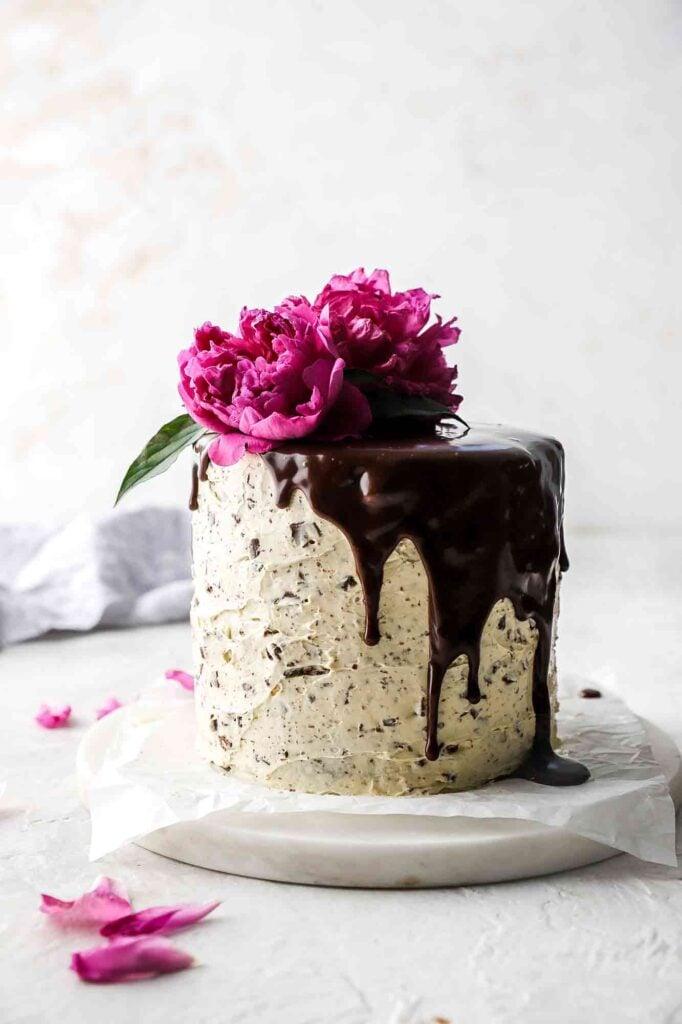 Chocolate Chip Almond Cake with chocolate ganache drip and pink flower
