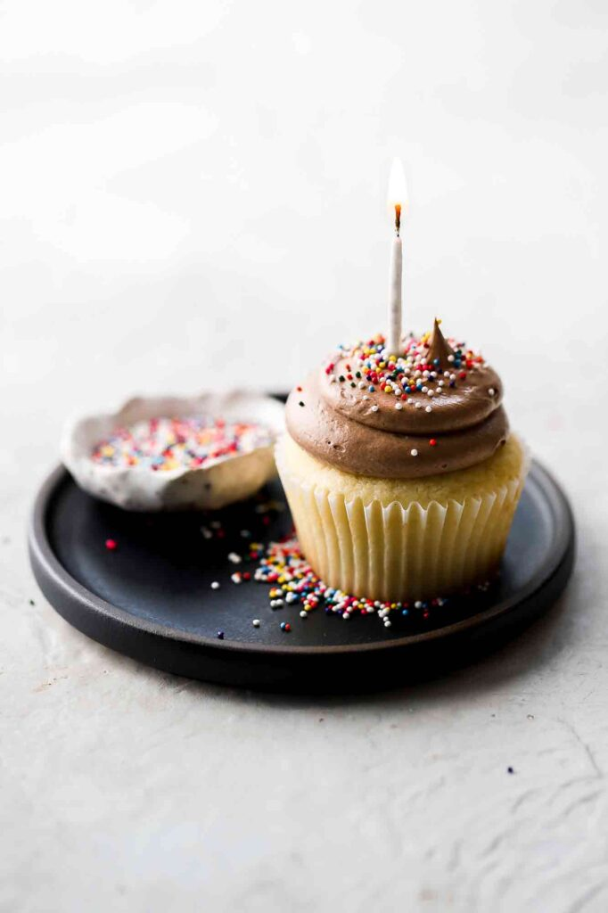 birthday cake cupcakes with candle and sprinkles